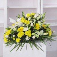 Cojín flores variadas tonos amarillos