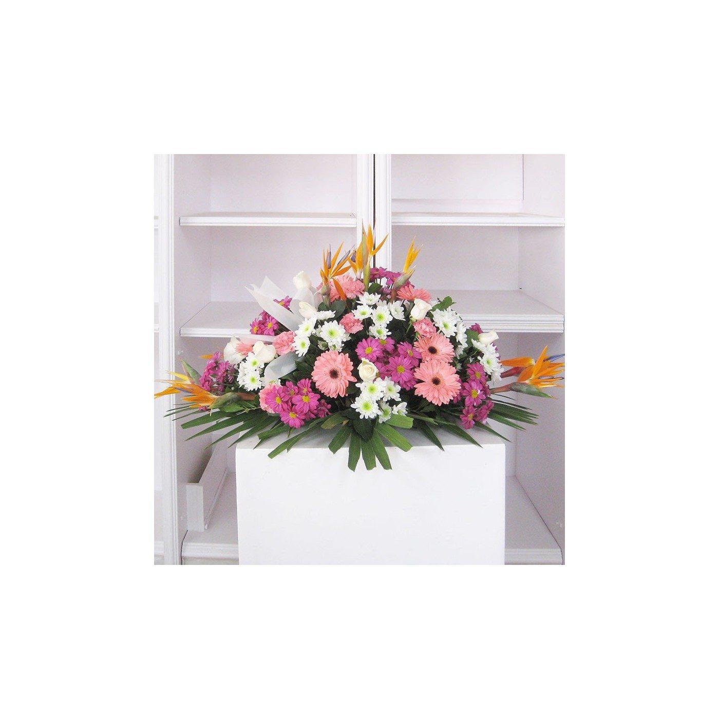 Cojín flores variadas tonos naranjas y morados