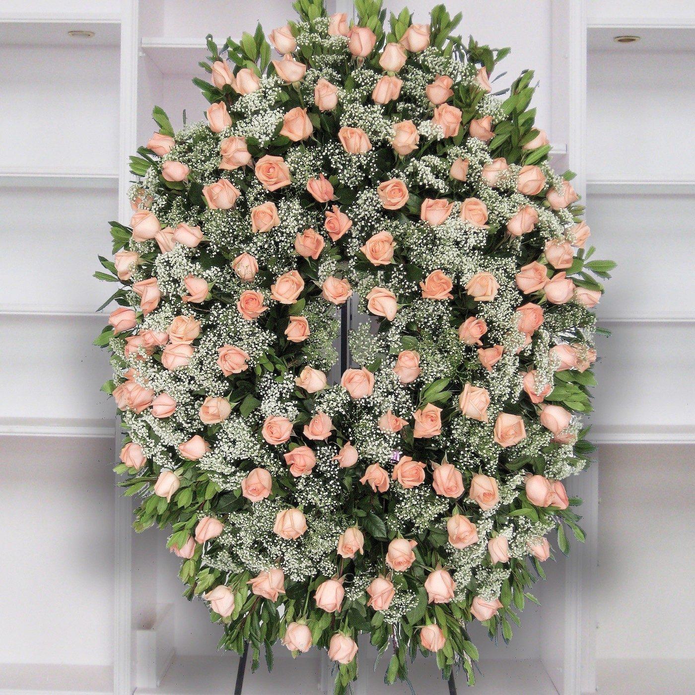 Corona de rosas rosas