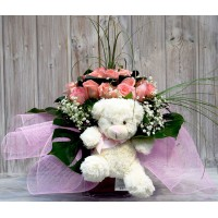 Vase with bouquet of 18 pink roses, paniculata and a little bear