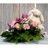 Varied flower basket with stuffed animal