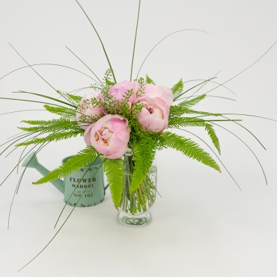 Bouquet of peonias in glass...